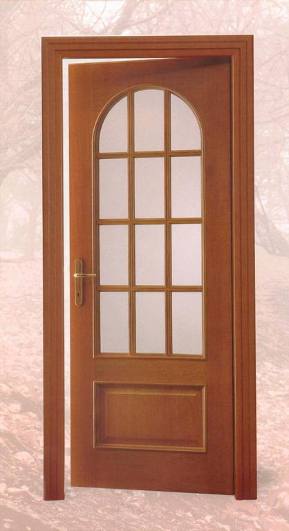 Poliwood realizza porte per interni in legno massello in - Porte ad arco ...